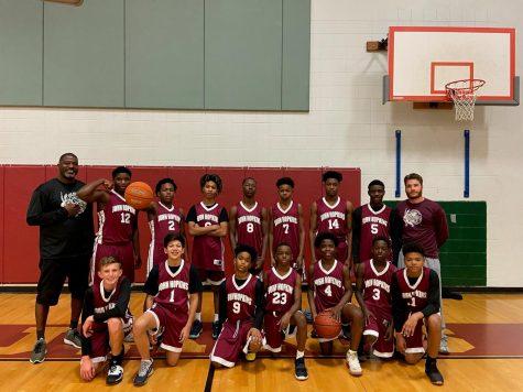 Boys basketball team posing