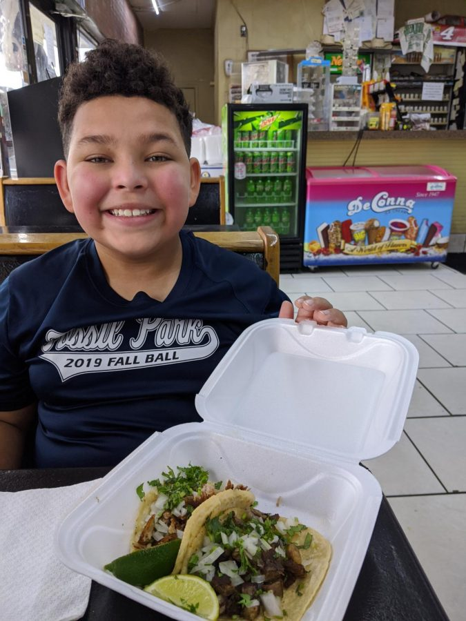 Student+posing+with+tacos